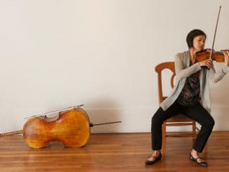 Violinist and Grammy Award-winner Karen Kim, warming up backstage prior to a Birdfoot Festival concert at Café Istanbul. Photo Credit: Ryan Hodgson-Rigsbee (rhrphoto.com)